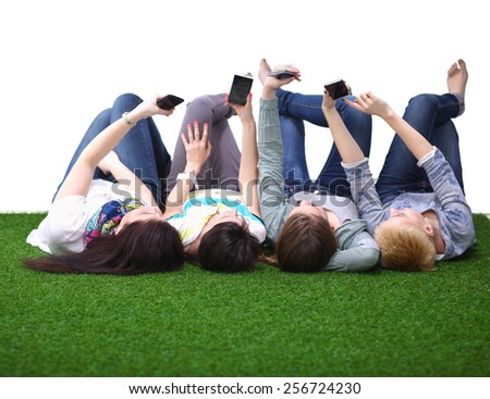 Group of young people having fun in Grass - stock photo