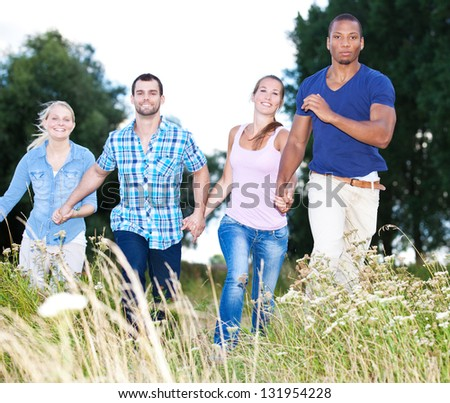 Group of young people having fun in nature - stock photo