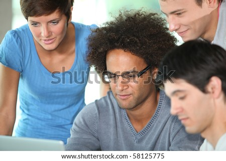 Group of young people in business meeting - stock photo
