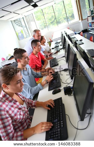 Group of young people in computing class - stock photo