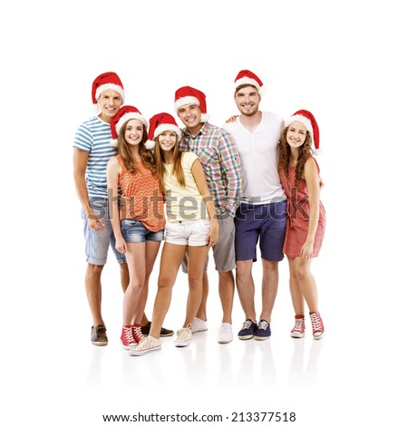 Group of young people in santa hats having fun, isolated on white background - stock photo