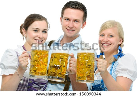 group of young people in traditional bavarian tracht holding Oktoberfest beer steins - stock photo
