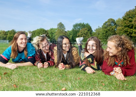 Group of young people lying in the park