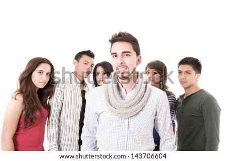 Group of young people, man at front, isolated on white background. - stock photo