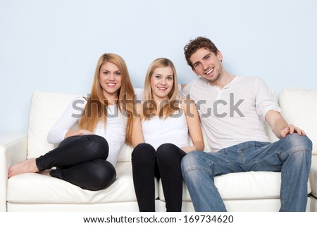 Group of young people on a sofa