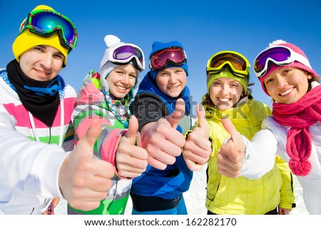 Group of young people on ski holiday in mountains  - stock photo