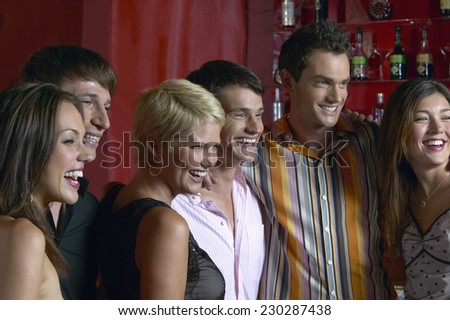 Group of Young People Posing at a Bar - stock photo