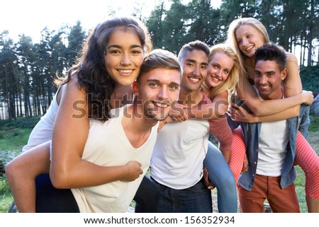 Group Of Young People Relaxing In Countryside