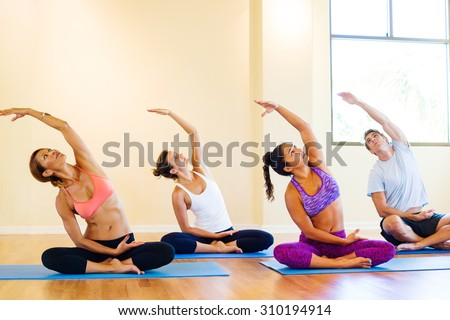 Group of Young People Relaxing Practicing Yoga, Healthy Lifestyle.