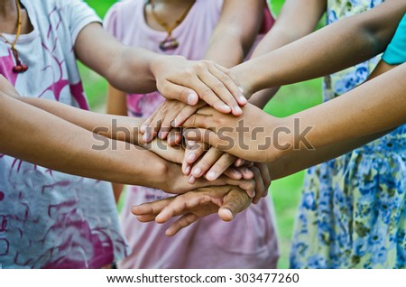 group of young people's hands