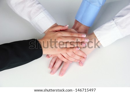 Group of young people's hands isolated on white