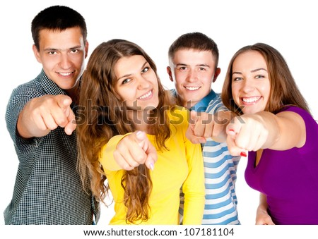 group of young people show forefingers into the camera - stock photo