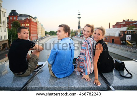 group of young people sitting relaxing in the industrial city. Youth Group Vacation Travel City Stock Photo 329701265   Shutterstock