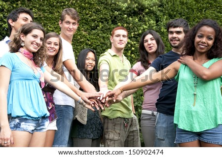 Group of young people smiling - stock photo