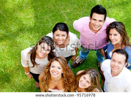 Group of young people smiling at the park - stock photo