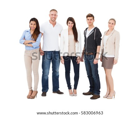 Group Of Young People Standing In Row On White Background
