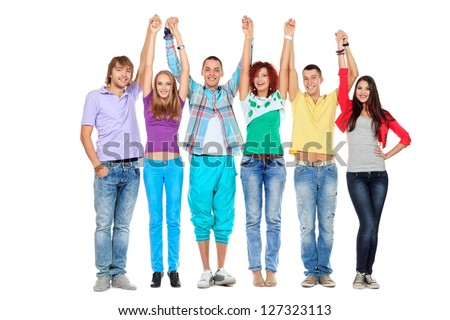 Group of young people standing together in line and raising their hands. Friendship. Isolated over white.