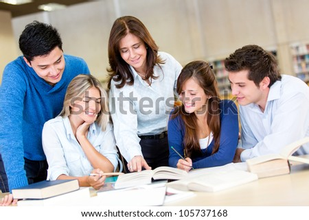 Group of young people studying at the library