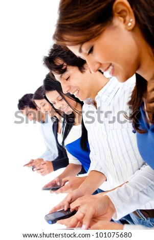 Group of young people texting on their phones - isolated over white - stock photo