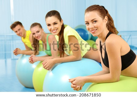Group of young people training with gymnastic ball - stock photo
