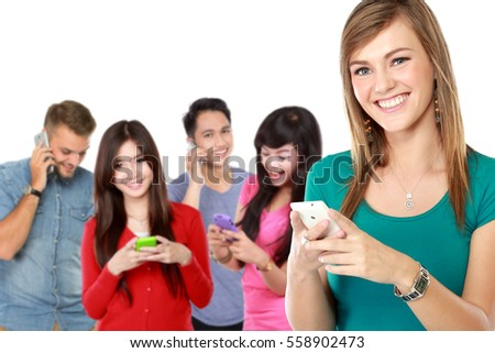 group of young people using mobile phone. attractive woman at the front