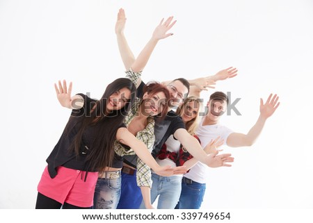 group of young people waving their hands - stock photo