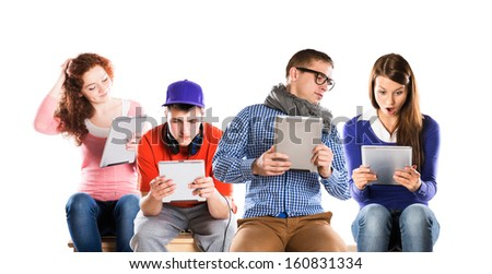 Group of young people with pc tablet, isolated on white background - stock photo