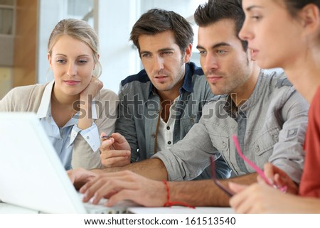 Group of young people working together in office - stock photo