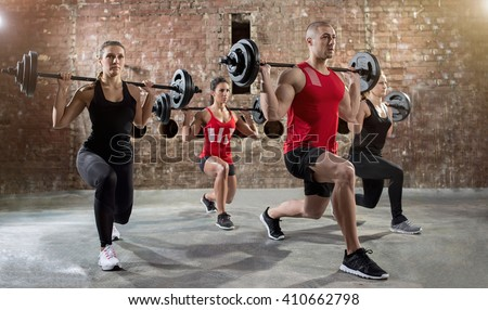 group of young people workout a exercise body pump