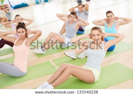 Group of young peple engaged in the gym