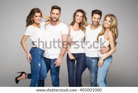 Group of young smiling models posing