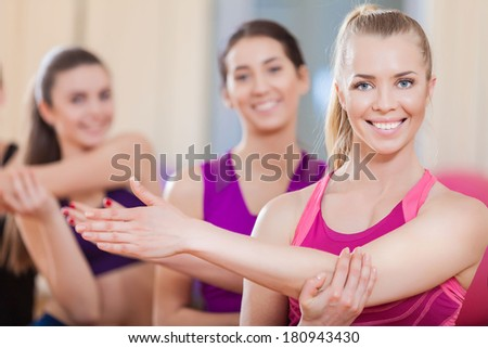 Group of young sport people in gym. Gym and Fitness. Smiling people. - stock photo