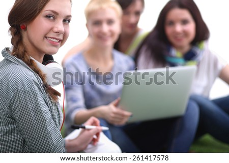 Group of young student using laptop together - stock photo