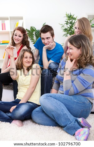 Group of young students having discussion about protection, sex education - stock photo