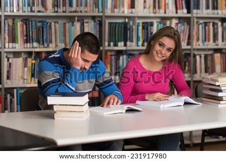 Group Of Young Students Sitting At The Library - Shallow Depth Of Field - stock photo