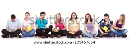 group of young students sitting on the floor  with books,  isolated on white background - stock photo