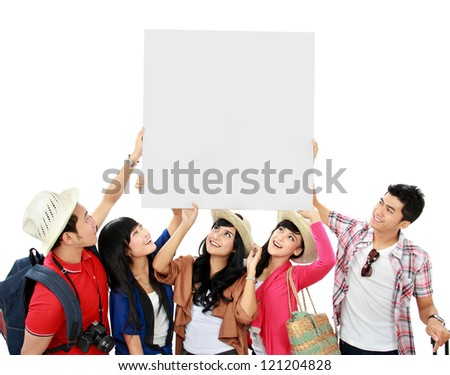 group of young tourist hold a white banner and look up - stock photo