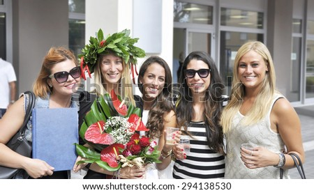 Group of young women celebrating graduation - stock photo