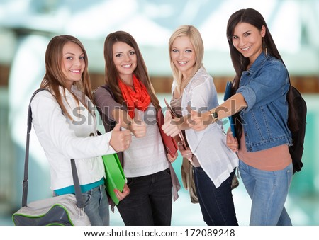 Group Of Young Women Friends Showing Thumb Up - stock photo