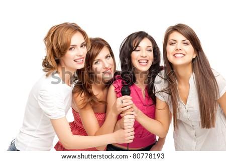group of young women having fun at karaoke - stock photo