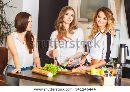 Group of young women in a kitchen room preparing food