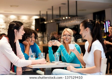 group of young women on coffee break, enjoying in discussion - stock photo