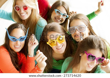 Group on young female friends having fun - stock photo