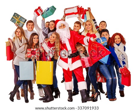 Group people and  Santa Clause holding gift box near  Christmas tree.
