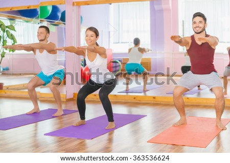 Group people doing squats, leg muscles pump up for sexy buttocks. Exercise strengthens a person physically and make them more happy! - stock photo