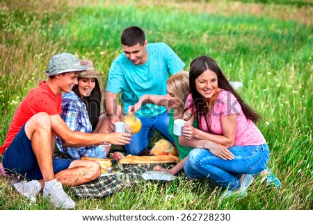 Group people male and female on picnic. Outdoor. - stock photo