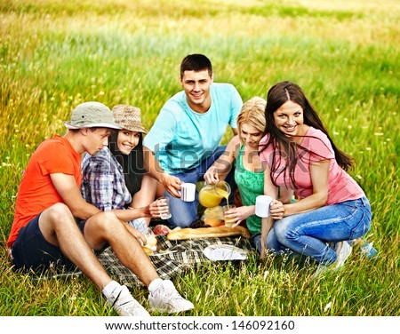 Group people on picnic. Outdoor. - stock photo