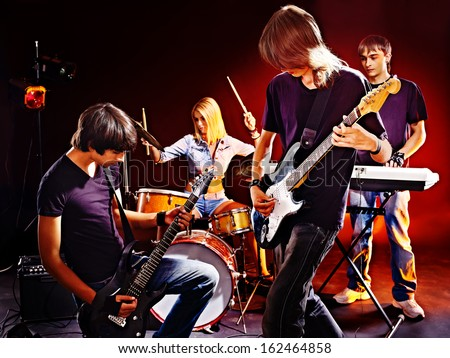 Group people playing  guitar in night club. - stock photo