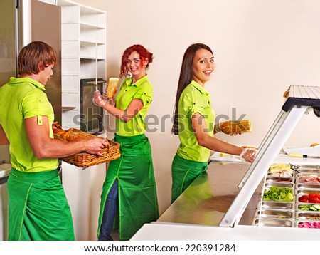 Group people selling food at cafeteria. - stock photo