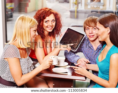 Group people using tablet computer at cafe . - stock photo